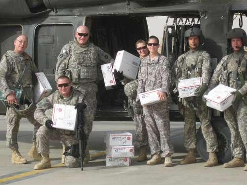 Minnesota Unit poses with received AnySoldier packages October 2009, Afghanistan Photo used courtesy AnySoldier.com