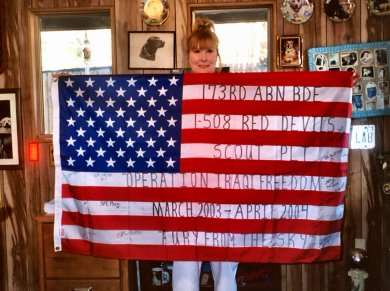 Sheryl with her flag from the 173rd Red Devils.